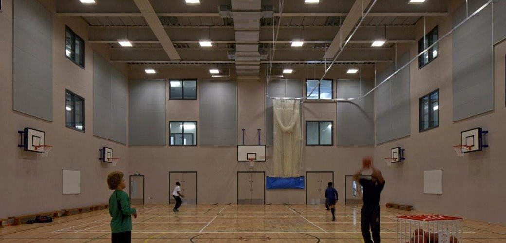 Flush fitting doorsets for the sports hall with fire rated containment screens above
